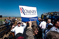 A supporter holds a sign after a speech by presumptive Republican candidate for President Mitt Romney (cq) at K.P. Kauffman Company in Fort Lupton, Colorado, Wednesday, May 9, 2012. Romney was giving a recovering the economy stump speech.<br /> <br /> Photo by MATT NAGER