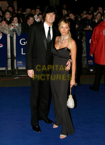 VERNON KAYE & TESS DALY.National Television Awards 2005 at the Royal Albert Hall, SW7, London, UK..October 25th, 2005.Ref: AH.Daley full length black dress suit celebrity couple married husband wife.www.capitalpictures.com.sales@capitalpictures.com.© Capital Pictures.