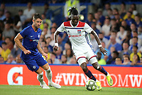 Bertrand Traore of Lyon in possession as Chelsea's Gary Cahill looks on during Chelsea vs Lyon, International Champions Cup Football at Stamford Bridge on 7th August 2018