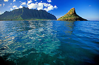Stunning view of Chinamans Hat and the sharply defined Koolau mountains shot from the ocean on the windward side of Oahu