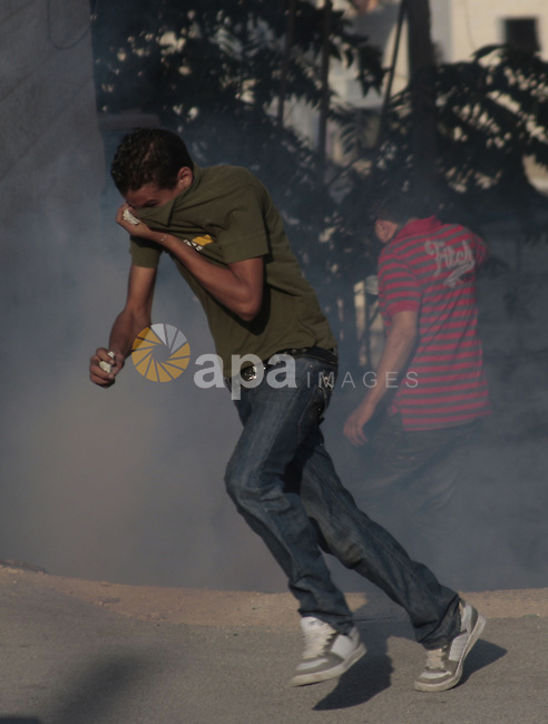 A Palestinian youth prepares to throw stones towards Israeli border police during clashes at the Kalandia checkpoint near the West Bank city of Ramallah October 8, 2009. Photo by Mohamar Awad