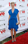 "Actress Amy Smart arrives at the Much Love Animal Rescue Presents The Second Annual ""Bow Wow WOW!"" at The Playboy Mansion on July 19, 2008 in Beverly Hills, California."