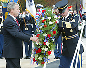 United States President George W. Bush lays a wreath at the Tomb of the Unknown Soldier during a ceremony commemorating Veterans Day at Arlington National Cemetery, November 11, 2003 in Arlington, Virginia. Bush gave remarks to veterans to mark Veterans Day.  <br /> Credit: Alex Wong / Pool via CNP