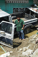 Felipe Lopez Monzon age 34 has spent the past two weeks trying to dig out his pick-up truck which is his only means by which to make a living.  Miguel de la Madrid neighbourhood, Tapachula Chiapas.