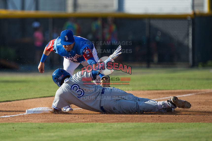 Earl Burl III (3) of the Bluefield Blue Jays is tagged out at third base by Emmanuel Rivera (24) of the Burlington Royals at Burlington Athletic Stadium on June 26, 2016 in Burlington, North Carolina.  The Blue Jays defeated the Royals 4-3.  (Brian Westerholt/Four Seam Images)