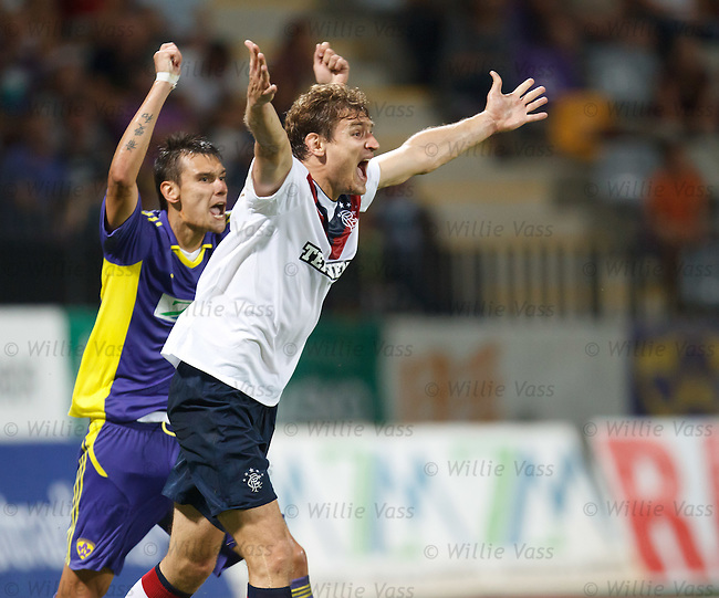 Nikica Jelavic appeals in vain to the referee for a handball in the box