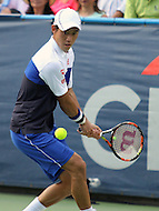 Washington, DC - August 9, 2015:  Kei Nishikori of Japan attempts a backhand shot during the Citi Open ATP men's singles final at the Rock Creek Park Tennis Center in Washington, DC  August 9, 2015.  (Photo by Elliott Brown/Media Images International)