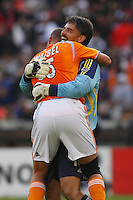 Houston Dynamo goalkeeper (18) Pat Onstad celebrates with defender (16) Craig Waibel at the final whistle. The Houston Dynamo defeated the New England Revolution 2-1 in the finals of the MLS Cup at RFK Memorial Stadium in Washington, D. C., on November 18, 2007.