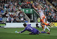 Blackpool's Mark Cullen shoots wide under pressure from Plymouth Argyle's Matt Macey<br /> <br /> Photographer Kevin Barnes/CameraSport<br /> <br /> The EFL Sky Bet League One - Plymouth Argyle v Blackpool - Saturday 15th September 2018 - Home Park - Plymouth<br /> <br /> World Copyright &copy; 2018 CameraSport. All rights reserved. 43 Linden Ave. Countesthorpe. Leicester. England. LE8 5PG - Tel: +44 (0) 116 277 4147 - admin@camerasport.com - www.camerasport.com