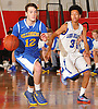 Steve Torre #12 of Kellenberg, left, looks to stay ahead of Joe Bourne #3 of Long Beach during a non-league varsity boys' basketball game at Freeport High School on Monday, Jan. 18, 2016. Kellenberg won by a score of 71-62.