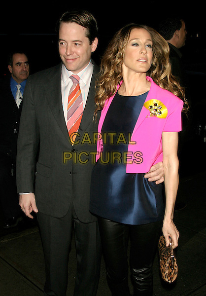 "MATTHEW BRODERICK & SARAH JESSICA PARKER.Special screening of ""Smart People"" hosted by The Cinema Society at the Landmark Sunshine Cinema, New York, NY, USA..March 31st, 2008.half 3/4 length black leather trousers blue top silk satin fluorescent pink cropped jacket leopard print clutch bag grey gray suit married husband wife .CAP/LNC/TOM.©TOM/LNC/Capital Pictures."