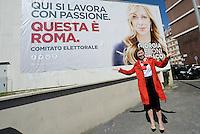 Roma 6 Maggio 2016<br /> Irene Pivetti con cappotto rosso posa davanti un cartellone elettorale.<br /> Presentazione delle liste a sostegno di Giorgia Meloni a Sindaca di Roma<br /> ROME, ITALY - May 06: <br /> Irene Pivetti with red coat posing in front of an electoral billboard.<br /> Presentation of the lists in support of Giorgia Meloni to mayor of Rome at the headquarters of the electoral campaign.<br /> on May 6, 2016 in Rome, Italy.