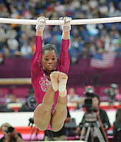 London, England - Thursday, August 2, 2012: USA's Gabrielle Douglas competes in the uneven bars and wins gold in the women's gymnastics individual all around at the London 2012 Summer, Olympic Games, North Greenwich Arena, London. .