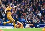 Joey Barton tackles Scott McDonald to win the ball