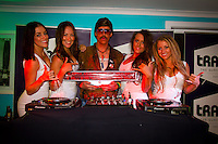 Torquay, Victoria/Australia (Monday, April 9, 2012) DJ Eddie and the Jim Beam girls. The 500th Issue Tracks party at Growlers Restaurant in Torquay attended by past editors Phil Jarratt (AUS), Gary Dunne (AUS),Neil Ridgway (AUS), current editor Luke Kennedy (AUS) surfers and friends of the magazine.Photo: joliphotos.com