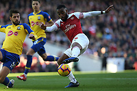 Alexandre Lacazette of Arsenal and Jack Stephens of Southampton during Arsenal vs Southampton, Premier League Football at the Emirates Stadium on 24th February 2019