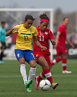 Brazilian player Marta (10) passes the ball as Canadian midfielder Desiree Scott (11) defends. In an international friendly, Canada defeated Brasil, 2-1, at Gillette Stadium on March 24, 2012.