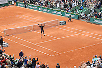 May 31, 2015: Jo-Wilfried Tsonga of France celebrates his win in a 4th round match against Tomas Berdych of Czech Republic on day eight of the 2015 French Open tennis tournament at Roland Garros in Paris, France. Tsonga won 63 62 67 63. Sydney Low/AsteriskImages
