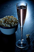 Rose Champagne or Cremant with a bowl popcorn.