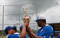 The blue team of Torneo Supremo holds their trophy after winning the championship in Boca Chica August 8, 2011 the tournament called Torneo Supremo which aims to maximize the ability of Major League Baseball organizations to scout in the Dominican Republic. El Torneo Supremo will consist of four teams playing one game per week in addition to a mid-tournament All-Star event, as well as championship and consolation games. Tournament participants will also be provided in-classroom education opportunities. April 2011. ViewPress/ ZZ