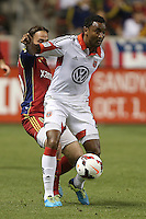 James Riley (r) of D.C. United fends off Ned Grabavoy (l) during the first half of the U.S. Open Cup Final on October  1, 2013 at Rio Tinto Stadium in Sandy, Utah.