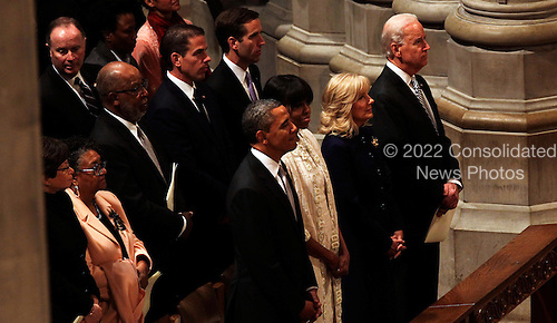 United States President Barack Obama, first Lady Michelle Obama, U.S. Vice President Joe Biden (R) and Dr. Jill Biden  (2R) attend the National Prayer Service at the Washington National Cathedral on January 22, 2013 in Washington, DC. It is a tradition for US Presidents to attend a prayer service on their first day in the office. .Credit: Aude Guerrucci / Pool via CNP