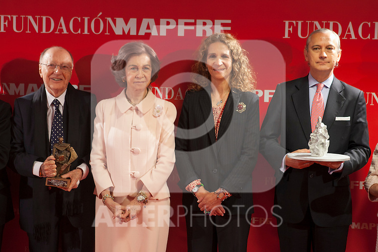 Queen Sofia of Spain and Enfant Elena of Spain pose with the awarded during the Mapfre Foundation Social Awards ceremony at Mapfre Campus in Madrid, Spain. May 20, 2014. (ALTERPHOTOS/Victor Blanco)