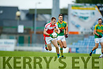 John Curran South Kerry in action against Barry O'Sullivan Dingle in the Quarter Final of the Kerry Senior County Championship at Austin Stack Park on Sunday.