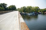 The Old Duke Road Bridge passes floating houses on the Mississippi River in Winona Minnesota USA