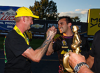 Sep 3, 2016; Clermont, IN, USA; NHRA pro stock driver Aaron Strong (left) is congratulated by Vincent Nobile as he celebrates after winning the postponed final round from the Seattle race that was rescheduled to run during qualifying for the US Nationals at Lucas Oil Raceway. Mandatory Credit: Mark J. Rebilas-USA TODAY Sports
