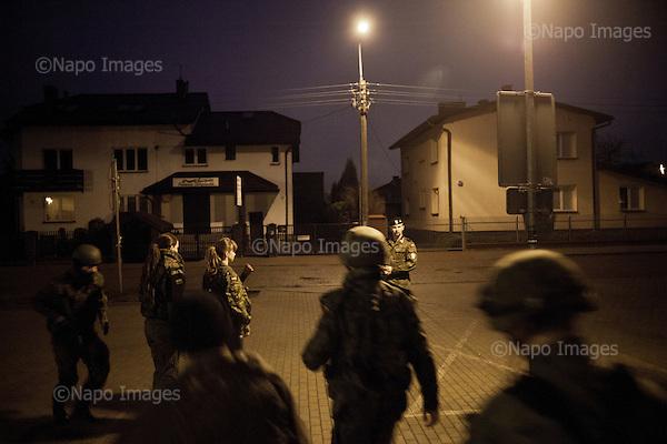LOMIANKI, 3/2015:<br /> Nocny alarm z replika broni. Czlonkowie organizacji &quot;Strzelec&quot; podczas obozu szkoleniowego w lokalnym gimnazjum. Od rozpoczecia wojny na Ukrainie rozne organizacje paramilitarne staja sie coraz bardziej popularne.<br /> Fot: Piotr Malecki<br /> <br /> LOMIANKI NEAR WARSAW, POLAND, MARCH 2015:<br /> Members of &quot;Strzelec&quot; (&quot;The Shooter&quot;) paramilitary association running to assembly point during night alarm on weekend training at one of the local schools.  (The guns are replicas of the real guns) <br /> Since the start of war in Ukraine, paramilitary associations are becoming more popular.<br /> (Photo by Piotr Malecki)