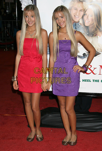"CAMILLA & REBECCA ROSSO.""Marley & Me"" Los Angeles Premiere held at the Mann Village Theater, Westwood, California, USA..December 11th, 2008.full length red purple strapless dress hand on hip holding hands twins sisters siblings family.CAP/ADM/MJ.©Michael Jade/AdMedia/Capital Pictures."