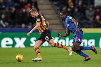 Bolton Wanderers' Clayton Donaldson chasing down Hull City's Stephen Kingsley<br /> <br /> Photographer Andrew Kearns/CameraSport<br /> <br /> The EFL Sky Bet Championship - Hull City v Bolton Wanderers - Tuesday 1st January 2019 - KC Stadium - Hull<br /> <br /> World Copyright © 2019 CameraSport. All rights reserved. 43 Linden Ave. Countesthorpe. Leicester. England. LE8 5PG - Tel: +44 (0) 116 277 4147 - admin@camerasport.com - www.camerasport.com