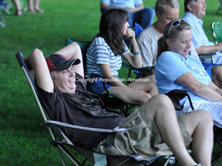 TORRINGTON, CT-15 JULY 2010-071610IP01- Richard and Lisa (right) Clarke of Winchester listen to the sounds of Night Moves Band during the Coe Park Concert Series in Coe Memorial Park in Torrington on Friday. Free concerts are held in the park on Tuesday and Friday evenings from 7-9pm, rain or shine.<br /> Irena Pastorello Republican-American