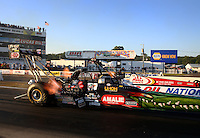 Aug. 16, 2013; Brainerd, MN, USA: NHRA top fuel dragster driver Terry McMillen (near lane) races alongside Doug Kalitta during qualifying for the Lucas Oil Nationals at Brainerd International Raceway. Mandatory Credit: Mark J. Rebilas-