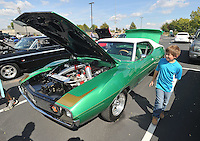 NWA Democrat-Gazette/MICHAEL WOODS • @NWAMICHAELW<br /> Brennan Shoemaker from Nashville Arkansas inspects his dads 1974 Javelin AMX during the 4th Annual Car/Truck Show Friday September 25, 2015 at Arvest Ballpark in Springdale.  The Car show continues Saturday with trophies given out for over 27 different categories including Best of Show, Engine, Paint, Upholstery, Undercarriage & Longest Distance. The 16th annual Bikes, Blues and BBQ Motorcycle Rally runs through Saturday on Dickson Street, Baum Stadium and the Washington County Fairgrounds in Fayetteville and all day Saturday at Arvest Ballpark in Springdale.
