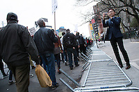 Protesters in New York City march past barracades that the people before them knocked over in an attempt to resist being confined to marching a specific route, and to stand with the people of Baltimore after the murder of Freddie Gray and in solidarity with the May 1st Coalition for Immigrant and Workers Rights on May 1st, 2015.