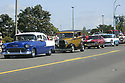 Vintage cars in parade at Whaling Days, Silverdale, WA Kitsap County community event. Stock photography by Olympic Photo Group