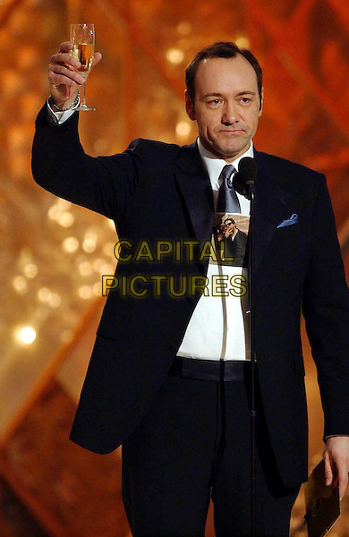 KEVIN SPACEY..Golden Globe Awards 2002..Ref: AW..champagne, toast, cheers, half length,half-length..www.capitalpictures.com..sales@capitalpictures.com..©Capital Pictures