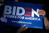 A supporter of 2020 Democratic Presidential candidate Joe Biden holds a campaign sign as she waits for Biden to arrive for the opening of a campaign office in Iowa City, Iowa on Wednesday, August 7, 2019. Biden is kicking off a 4 day tour of Iowa. Credit: Alex Edelman / CNP