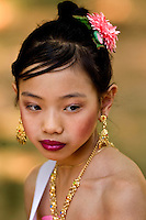 A girl dressed in traditional Asian attire looks on during dancing at the Charlotte Dragonboat Association racing on Lake Norman in NC.