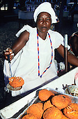 Bahia State, Brazil. Street vendor selling Acaraje - fried bean flour and shrimp pattie.