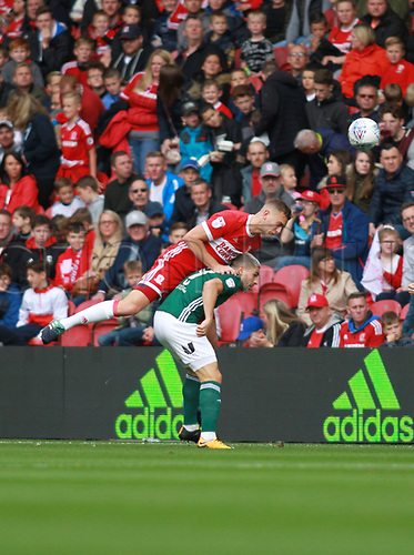 30th September 2017, Riverside Stadium, Middlesbrough, England; EFL Championship football, Middlesbrough versus Brentford; Ben Gibson of Middlesbrough wins a header against Neal Maupay of Brentford