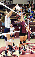 Photo by Randy Moll<br /> Brieann Ward, Gentry senior, attempts to tip the ball over the net against Shiloh Christian during play between the two teams at Gentry High School on Thursday, Sept. 10, 2015.