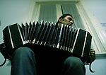 Pablo Ciriberto, 22, plays the bandoneon (a small accordion, a  German bellows instruments that produce the quintessential sound of the tango) during a music class in which students were asked to put a new music to and old tango song, at the National Academy of Tango in Buenos Aires, May 16, 2003.. Photo by Quique Kierszenbaum