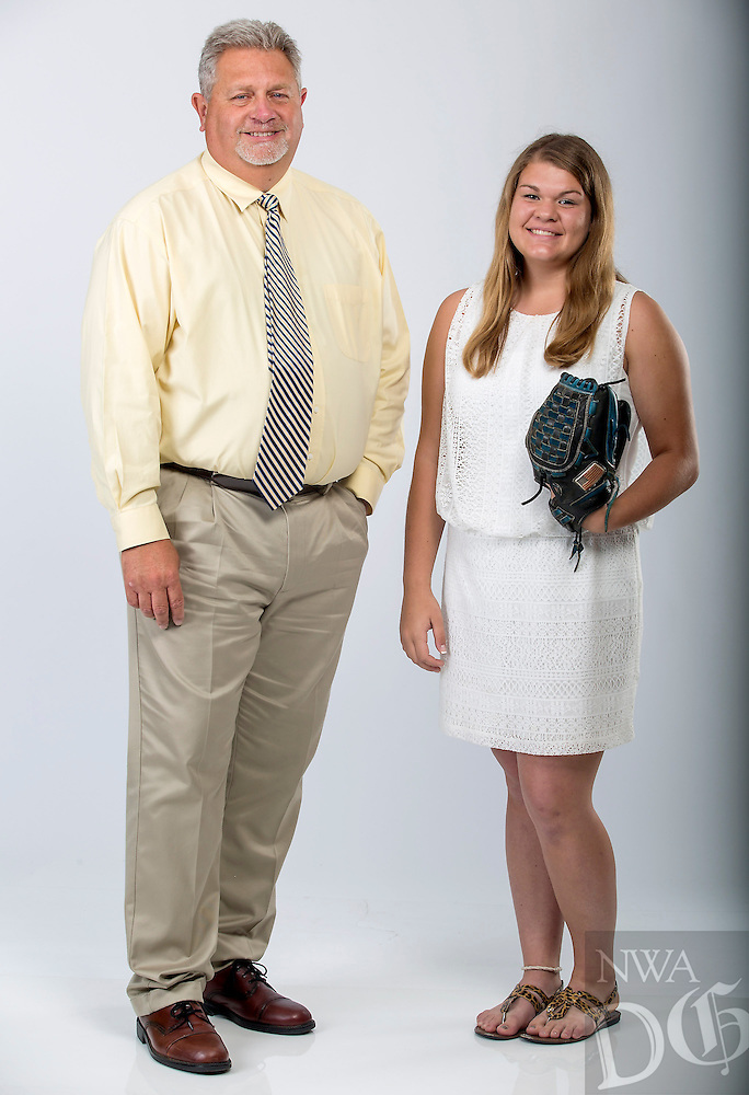 NWA Democrat-Gazette/JASON IVESTER --05/26/2015--<br /> Mike Harper, Rogers High; softball coach of the year; and Maddie Massanelli, Rogers High; softball player of the year; photographed on Tuesday, May 26, 2015, in Springdale office studio