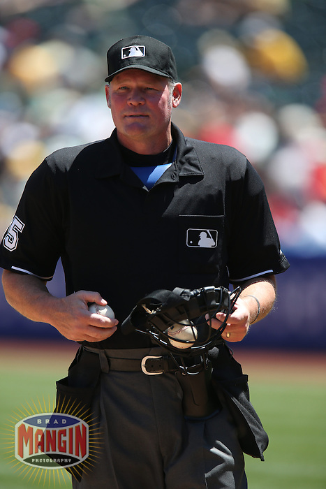 OAKLAND, CA - APRIL 30:  Home plate umpire Ted Barrett works the game between the Los Angeles Angels and Oakland Athletics at O.co Coliseum on Thursday, April 30, 2015 in Oakland, California. Photo by Brad Mangin