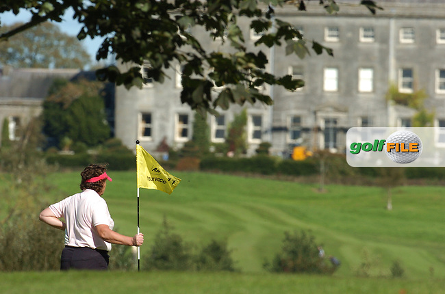 4th October, 2006 AA Insurance Ladies Championships All Ireland Finals held at Headfort Golf Club, Kells, County Meath..A lady golfer on the 15th green with Headfort Demesne in the background..Photo: BARRY CRONIN/Newsfile..(Photo credit should read BARRY CRONIN/NEWSFILE).
