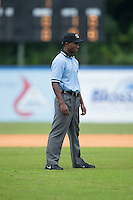 Umpire Darrell Roberts handles the call on the bases during the Appalachian League game between the Greeneville Astros and the Kingsport Mets at Hunter Wright Stadium on July 7, 2015 in Kingsport, Tennessee.  The Mets defeated the Astros 6-4. (Brian Westerholt/Four Seam Images)