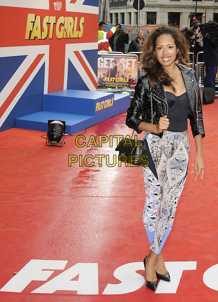 Jade Ewen.The 'Fast Girls' UK film premiere, Odeon West End cinema, Leicester Square, London, England..June 7th, 2012.full length black top leather jacket bag purse blue white print trousers .CAP/CAN.©Can Nguyen/Capital Pictures.
